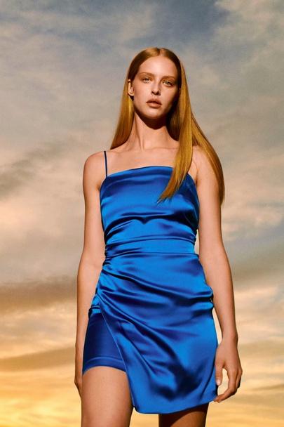 Wholesale New Style Fold Decoration Irregular Sling Pure Color Dress NSAM55755